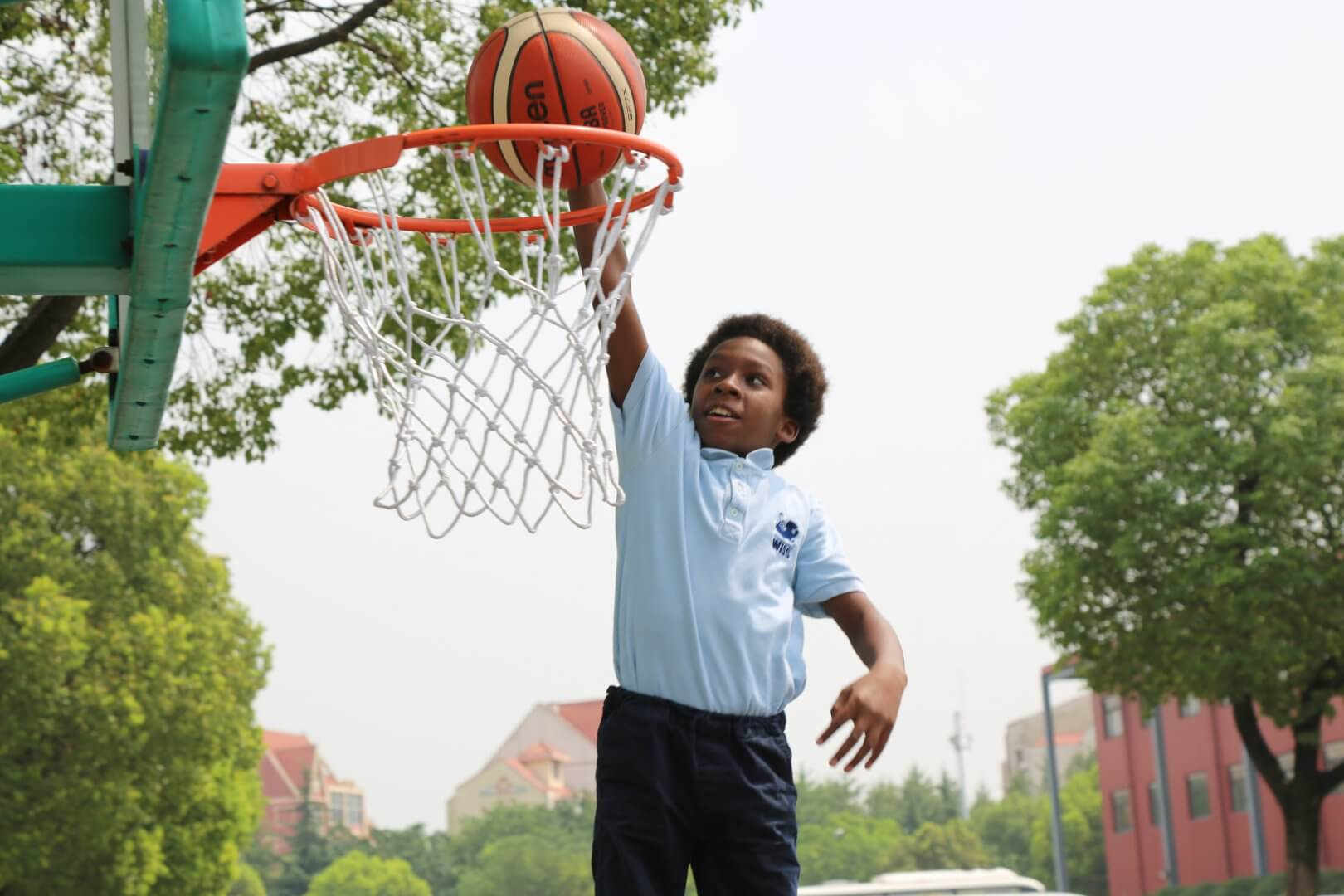 Christopher playing basketball at WISS
