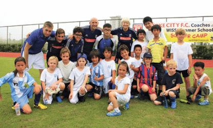 Stoke coaches get a kick out of summer camp in Shanghai