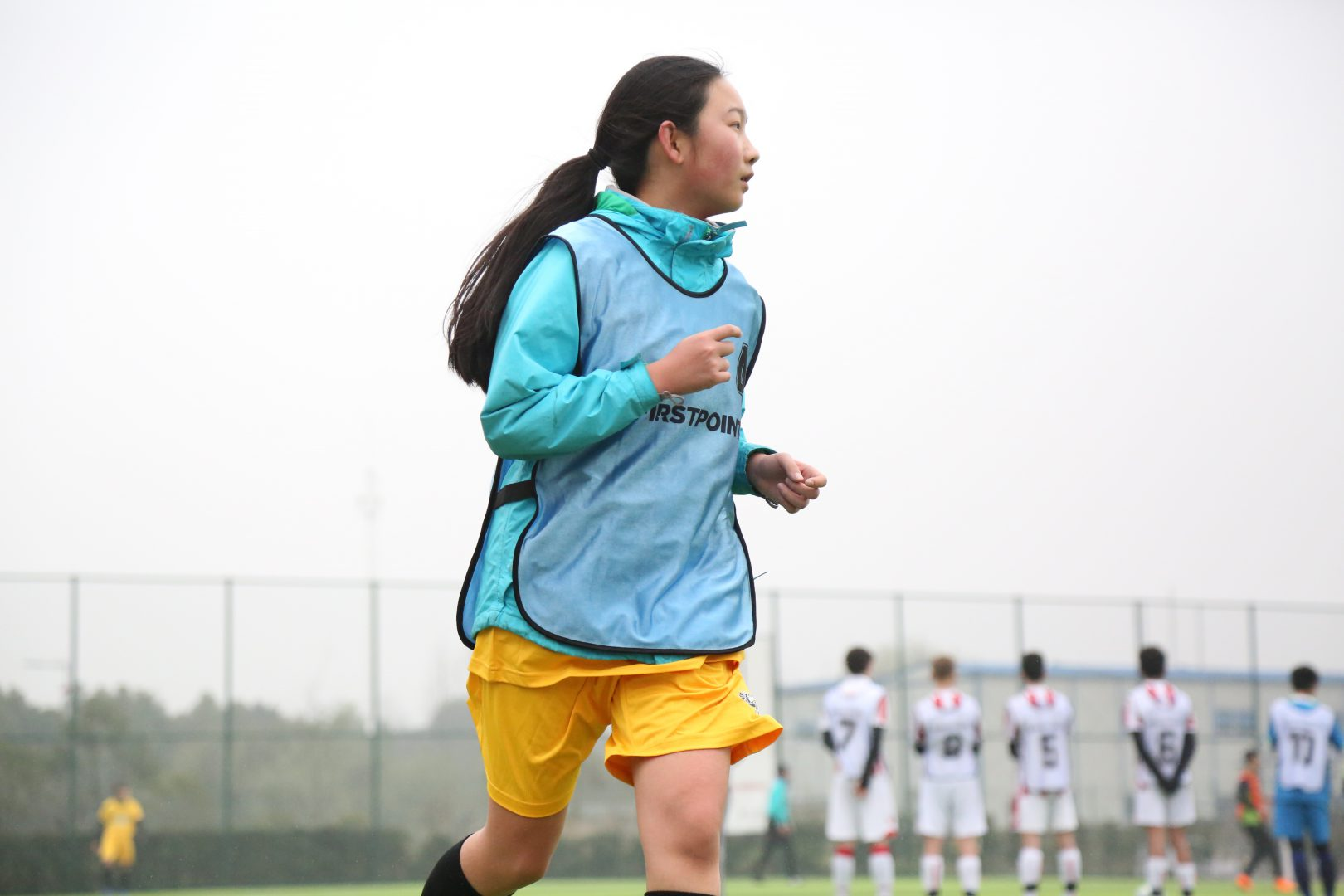 Football players in the Stoke City Field at The Western International School of Shanghai (WISS)