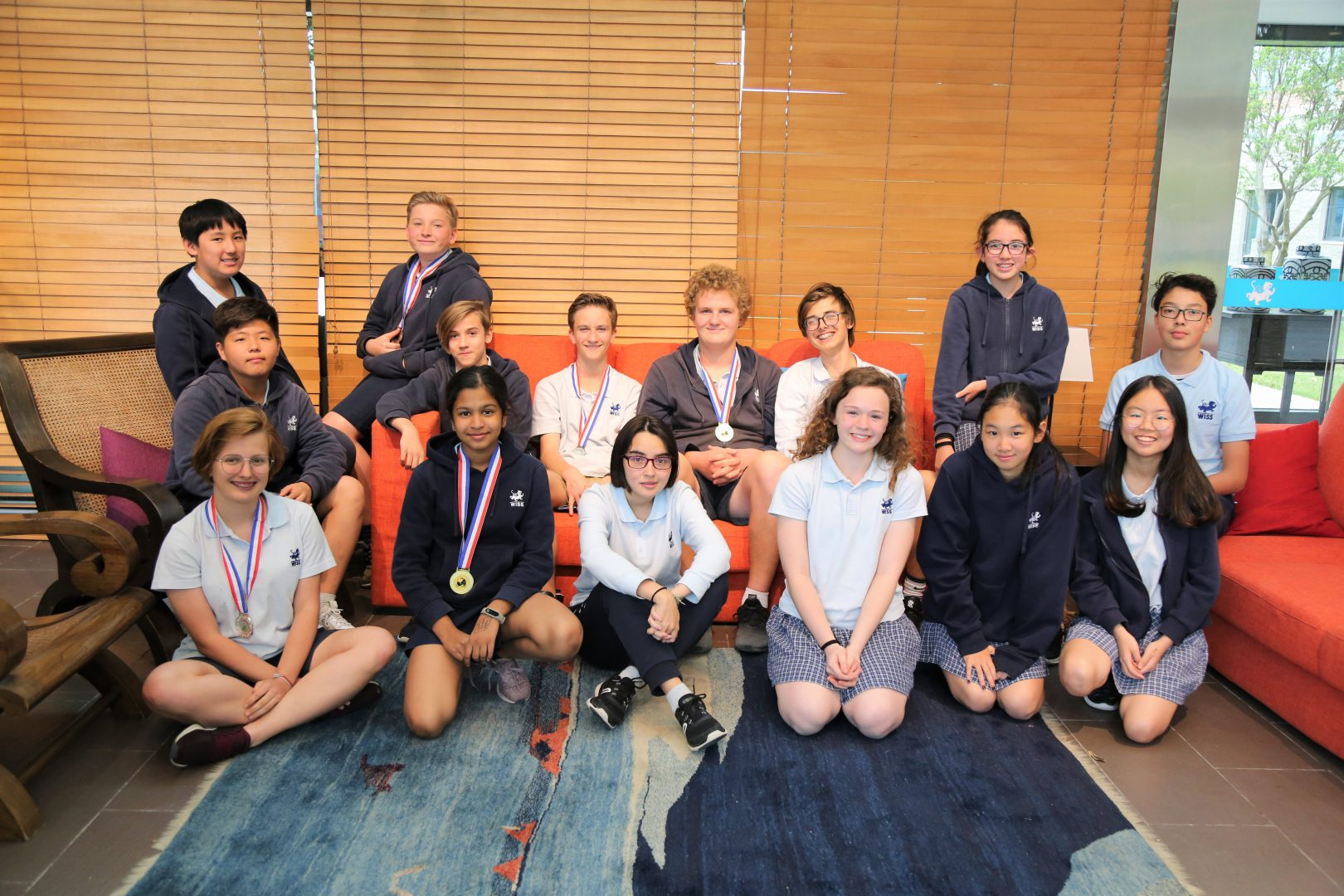 WISS students with their medals